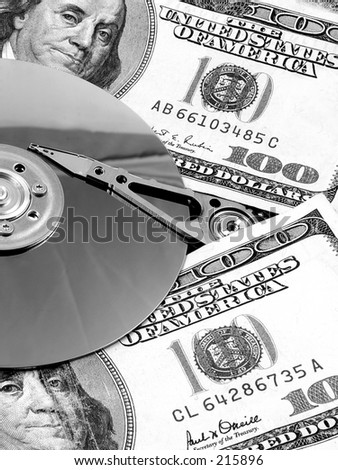 A hard drive platter surrounded by money. Signifying the high cost of storage and bandwidth