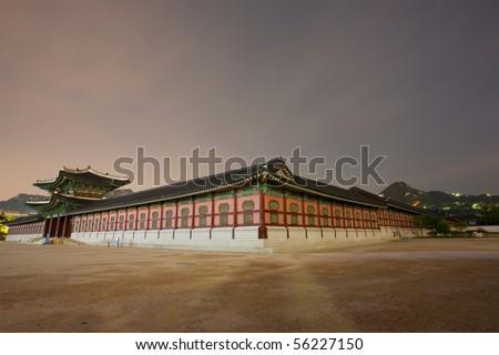 A haunting long exposure of Geyongbokgung royal Palace at night - stock photo
