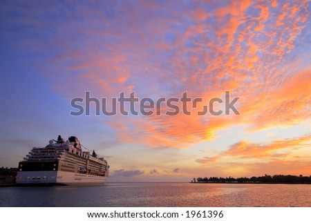 A Hawaiian cruise ship or liner at sunset ready to depart - stock photo