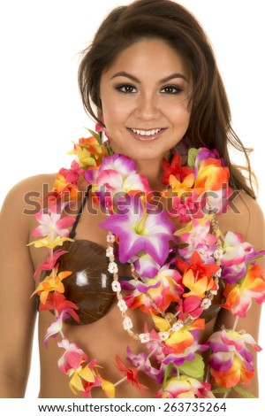 a Hawaiian woman in her coconut bra with her flower lei around her neck. - stock photo