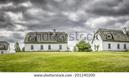 A hdr image of three thatched houses in Ireland - stock photo