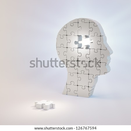 A head build out of puzzle pieces - stock photo