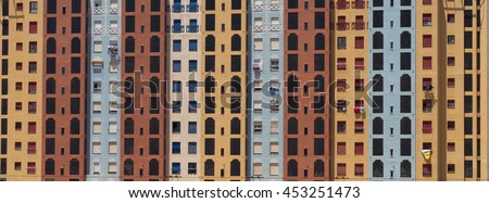 A head on view of social housing - colourful flats or apartments sunlit. Situated in Mucia, Spain