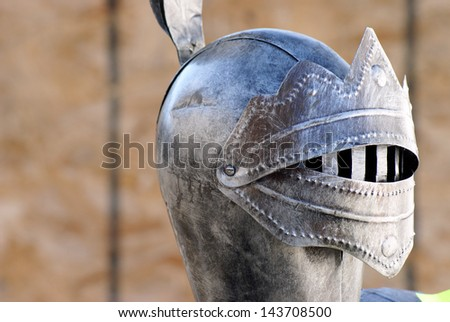 A headshot of a knights metal armor. - stock photo