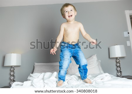 A Healthy Lifestyle of young little children boy on bed - stock photo