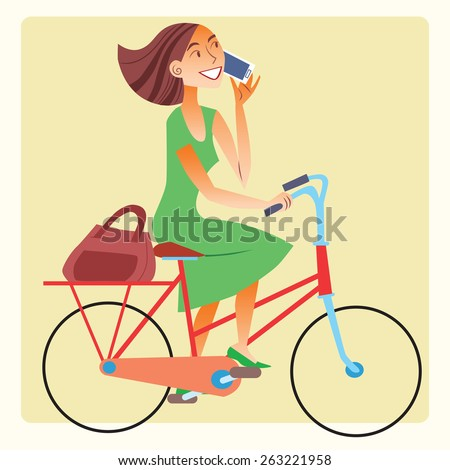 A healthy way of life. Young woman riding a bike and talking on the smartphone