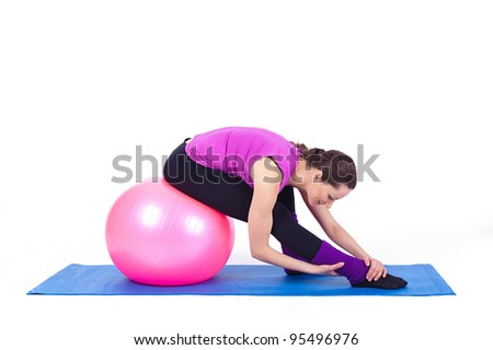 A healthy young woman exercising with fit-ball in gym. A series of photos in various poses in my image gallery. Isolated