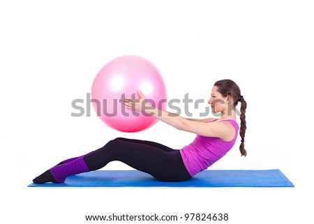 A healthy young woman exercising with fit-ball in gym. A series of photos in various poses in my portfolio. - stock photo