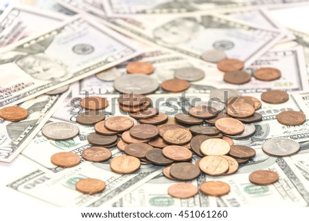 A heap of cents on the  hundred and fifty dollars banknotes - stock photo
