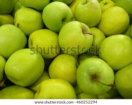 a heap of fresh round green apples