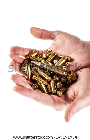 a heap of 9mm pistol bullets holded by human hands isolated over a white backgrounds - stock photo