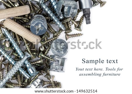 A heap of tools for assembling furniture over white background - stock photo