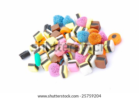 A heap of various colorful candies in different shapes for kids isolated on white studio background