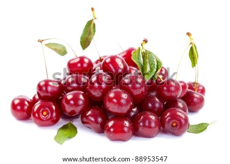 A heap of wet cherries on white background