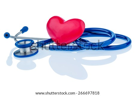 a heart and a stethoscope are adjacent. symbolic photo for heart disease and heartache. - stock photo