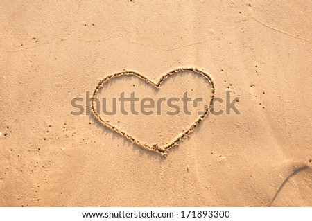 a heart in the sand on the beach