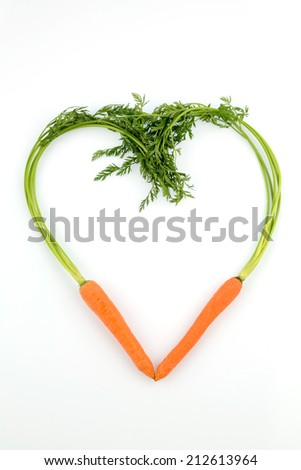 a heart made from organically grown carrots. fresh fruit and vegetables are always healthy. symbolic photo for healthy nutrition. - stock photo