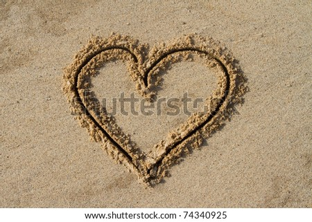 A heart shape drawn in the sand - stock photo