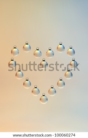A heart shape made out of Christmas baubles. Christmas ornament. - stock photo
