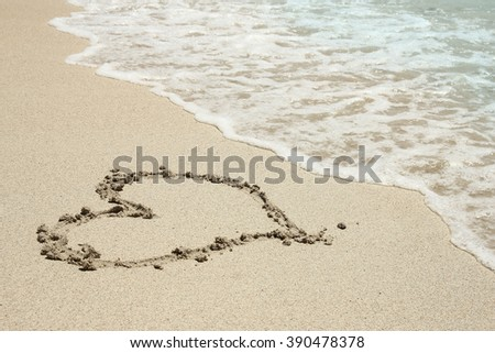 a heart trace in the sand seashore
