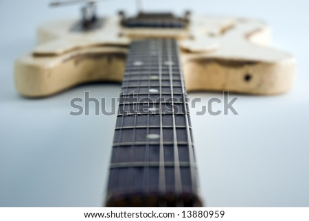 A heavily used electric guitar. Focus on 5th fret.