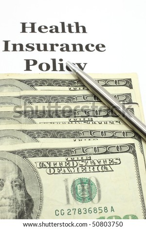 A helath insurance policy with hundred dollar bills and a pen for signing.  Signifies cost of healt care.