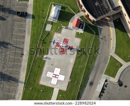 A helicopter pad for medical emergency flights to a modern hospital - stock photo