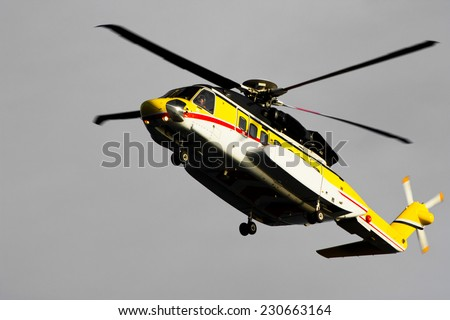 A helicopter transporting roughnecks to nearby rigs - stock photo