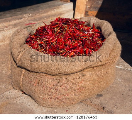 A hessian sack of dried red chillis