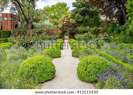 Beautiful English Flower Garden beautiful english style garden hedges symmetrical stock photo