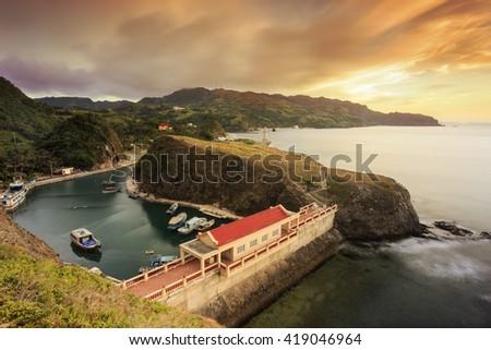 a hidden shelter port on a sunset mountain - stock photo