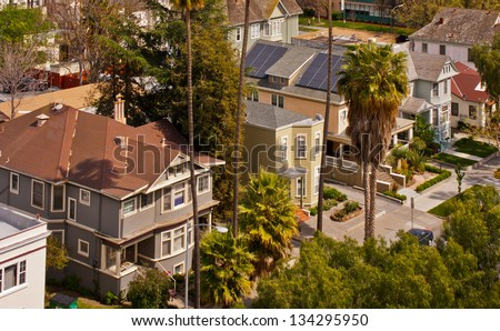 A high angle view of a row of Victorian style houses in San Jose, California. - stock photo