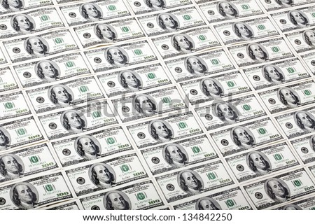 A high angle view of a very large amount of 100 US$ money notes. - stock photo