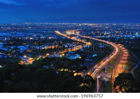 A high angle view of city lights at night.
