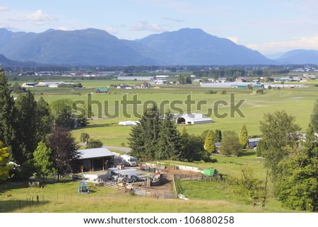 A high angle view of the Fraser Valley near Abbotsford, BC/Summer in the Fraser Valley/Summer has arrived in British Columbia's Fraser Valley - stock photo