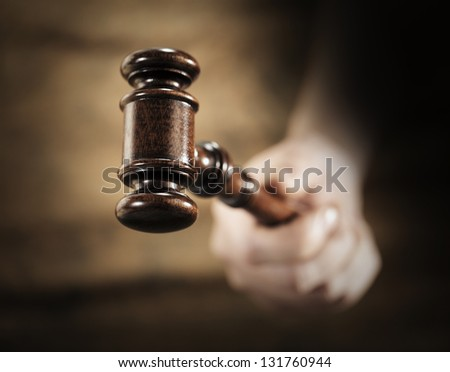A high quality mahogany wooden gavel. Very short depth-of-field. - stock photo