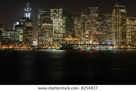 A high-resolution stitched image of San Francisco downtown in Christmas lighting at dusk (shot from Treasure Island). Copyspace at bottom. This lighting can be seen for 1.5 months in a year.