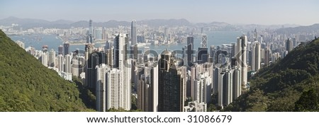 A high resolution view of Hong Kong with Victoria Harbor and Kowloon in the background during the day (http://www.artistovision.com/hongkong/hong-kong-day-scene.html).