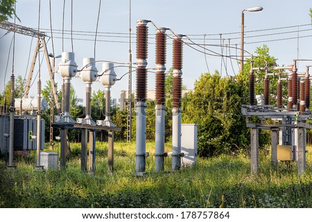 A high-voltage support with conductors and insulators - stock photo