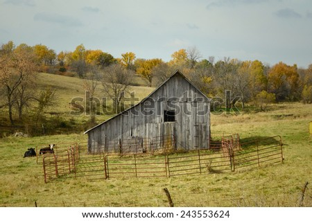 A highway barn in the autumn of Iowa. - stock photo