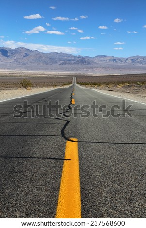 a highway leading into Death Valley California - stock photo