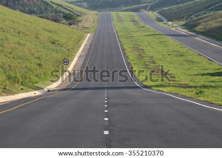 A highway stretches off into the distance. - stock photo