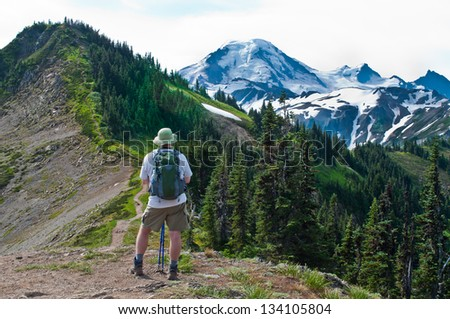 A hiker looks out towards the next adventure - stock photo