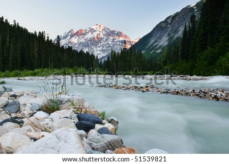 A hiking view of Sala creek in sunset from camping site. - stock photo