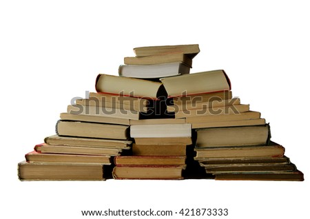 A hill of old books isolated on white.