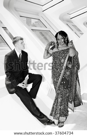 A hindu bride and american groom enjoy time together - stock photo