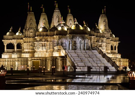 A Hindu Temple at night lit up.
