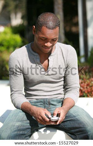 a hip young black guy is Shocked by the images he just saw on his cell phone sent to him - stock photo