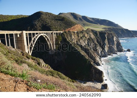 a historic bixby bridge along coastline california route one - stock photo