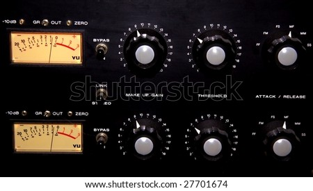 A historic equalizer in a recording studio - stock photo